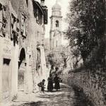 La strada principale del paese ai primi del Novecento